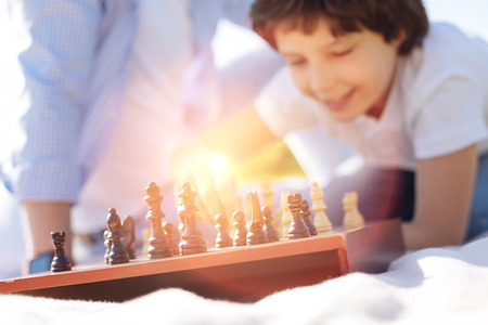 strategic focus: Enthusiastic bright child playing chess Stock Photo