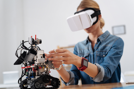 Brave woman testing visual reality gadget in the lab Stock Photo