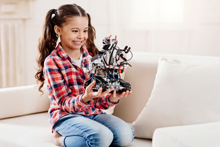 Delighted girl playing with robot Reklamní fotografie