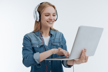 Positive delighted young woman working with computer Stock Photo