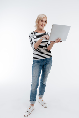 Full length photo of stylish mature woman that working with computer