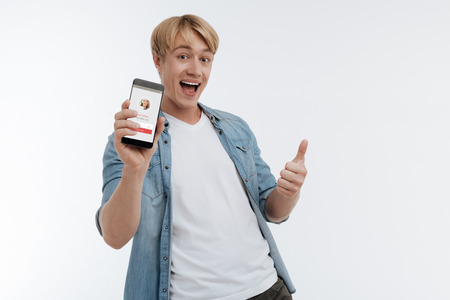 Happy man keeping friendly smile on his face Stock Photo