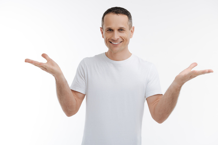 Positive male person keeping smile on his face