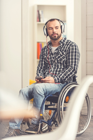 Disabled young man listening to radio