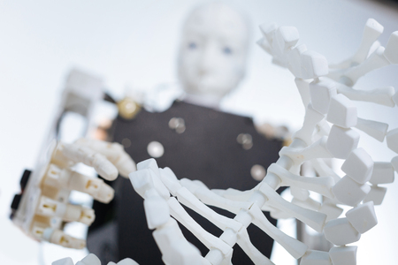 genomics: Picture of the robot and plastic genome model Stock Photo