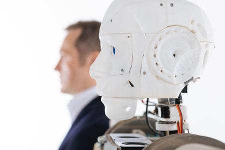 Profielfoto van een robot en zijn prototype Stockfoto