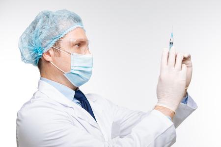 genomics: Proficient neat doctor preparing an injection Stock Photo