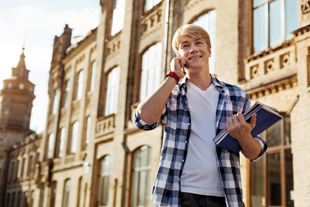 Attractive positive guy talking on the phone Stock Photo