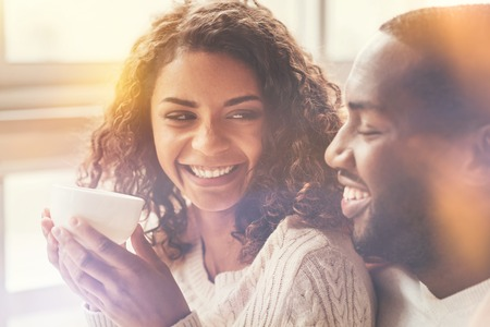 Happy delighted woman looking at her boyfriend Stock Photo