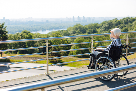 Inspired disabled lady looking at the city skyline