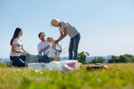 Progressive open minded people assisting with litter gathering