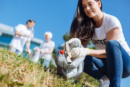 Nice progressive woman making an effort to help the environment Stock Photo