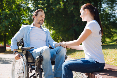Wonderful woman helping young man going through his recovery Stock Photo