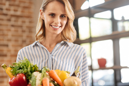 Young admirable woman committed to her lifestyle Stock Photo