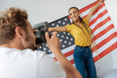 Young female person being proud of living in America Stock Photo