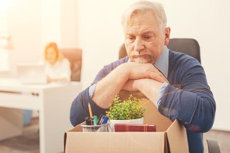 Sad thoughtful gentleman missing his job