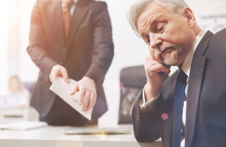 Irritated exhausted executive tired of his employees excuses Stock Photo