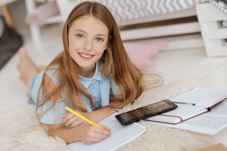 Girl of unearthly beauty smiling into camera Stock Photo