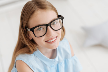 Portrait of adorable girl wearing glasses smiling Stock Photo