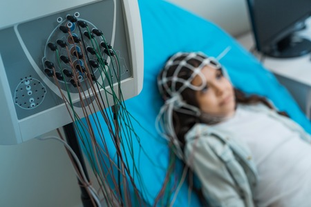 Little girl undergoing electroencephalography procedure Stock Photo