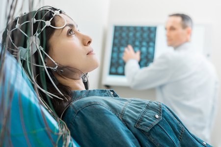 Charming young woman undergoing electroencephalography Stock Photo