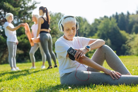Relaxed mature woman looking at her phone Stock Photo