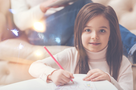Talented persistent girl drawing something Stock Photo