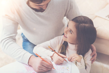 Daughter and father making a present for mom Stock Photo