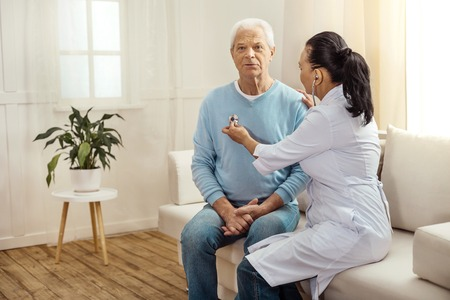 Nice aged man sitting on the sofa