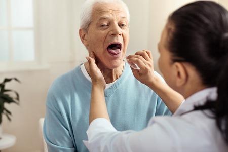 Nice professional nurse holding a plastic stick
