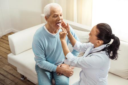 Pleasant elderly man doing a medical checkup Stock Photo