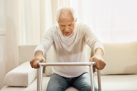 concern: Nice elderly man using a walker