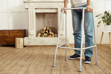 Walking frame being in use Stock Photo