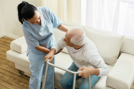 Pleasant friendly caregiver doing her job