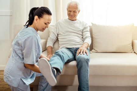 Joyful positive man following the rehabilitation program Standard-Bild
