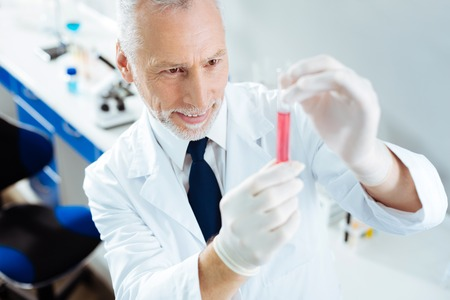 Positive delighted researcher shaking reagent