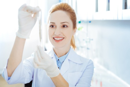 Positive delighted woman checking her sample Stock Photo