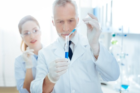 Competent scientist doing difficult experiment