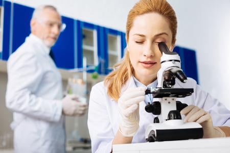 Competent practitioner doing reagent examination Stock Photo