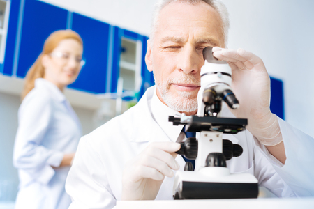 Serious practitioner working in modern laboratory