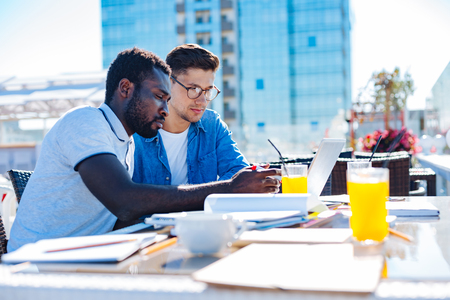 Male colleagues working on business project together Stock Photo
