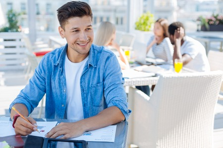 Attractive male student studying in cafe
