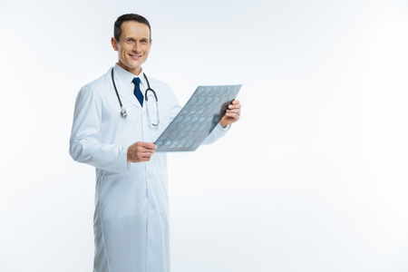 Cheerful medical professional posing with x ray scan