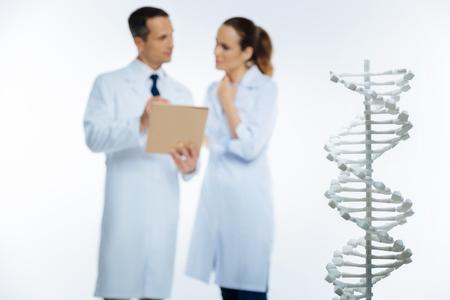 genomics: Selective focus on white monochrome dna model
