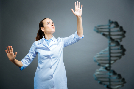 genomics: Female medical worker touching invisible screen Stock Photo