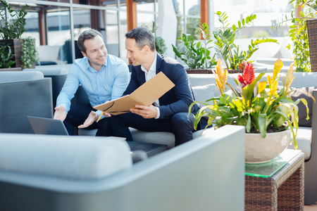 Delighted smart businessmen talking to each other Stock Photo