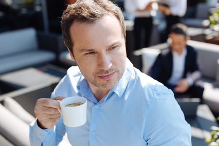 Serious thoughtful man drinking espresso Stock Photo
