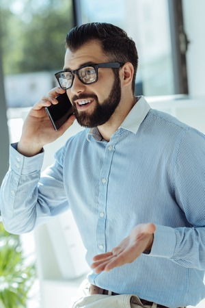 Young businessman arguing with colleague on the phone