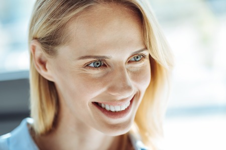 Close up of beautiful smiling fair-haired woman Stock Photo