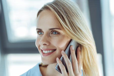 Happy woman having a conversation on the phone Stock Photo